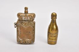 TWO BRASS VESTA CASES, the first in the form of a 'Veuve Cliquot' champagne bottle, hinged at the
