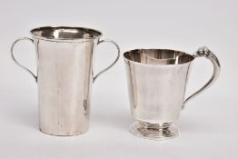 TWO EARLY 20TH CENTURY CHRISTENING CUPS, the first of plain tapered form, the top handle terminal