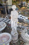 A MODERN COMPOSITE GARDEN FIGURE of a Grecian lady on top of a cylindrical base total height 126cm