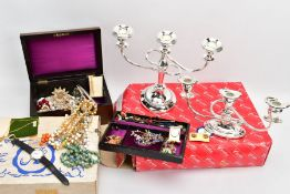 TWO SILVER PLATED CANDELABRAS AND A BOX OF COSTUME JEWELLERY, to include a short three branch silver