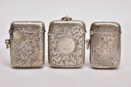 THREE SILVER VESTAS, the first with an engine turned design and floral detailing, engraved