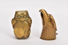 TWO BRASS VESTA CASES, the first in the form of an eagle head, with orange paste set to one eye,