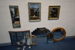 A COLLECTION OF MIRRORS to include three giltwood, pine oval framed, and a decorative stepped