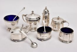 A SELECTION OF SILVER SALTS AND MUSTARDS, to include three two-piece salt and mustard sets, the