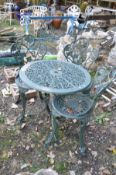 A MODERN CAST ALUMINIUM PAINTED GARDEN TABLE with pierced decoration and three matching chairs (