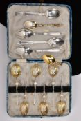 A CASED SET OF SIX SILVER TEASPOONS AND OTHERS, the case set of spoons, each decorated with embossed