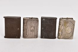FOUR BOOK-SHAPED VESTA CASES, to include two vulcanite cases one depicting king George, the other