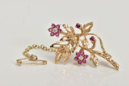 A YELLOW METAL RUBY AND DIAMOND BROOCH, cast brooch of a floral form, the two flower heads set