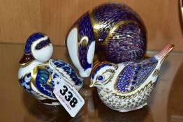 THREE ROYAL CROWN DERBY PAPERWEIGHTS, comprising Badger, Goldcrest and Sitting Duckling, Badger