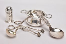 FIVE ITEMS OF SILVERWARE, to include a pair of sugar tongs with scrolling detail and shell shaped