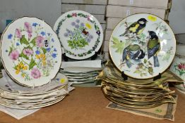 TWENTY FIVE COLLECTORS PLATES with boxes and certificates of authenticity, themes to include