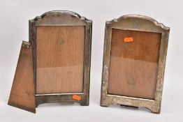TWO EARLY 20TH CENTURY SILVER PHOTOGRAPH FRAMES, both of a similar design with arched top, one