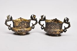 A PAIR OF LATE VICTORIAN SILVER GILT SALT CELLARS, each of an oval form, embossed floral and