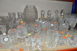 A LARGE QUANTITY OF CUT GLASS AND CRYSTAL to include an oversized brandy glass, approximate height