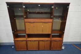 A 3 PIECE WALL UNIT, with smoked glass doors and various shelves and cupboard doors, overall width