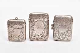 THREE LATE VICTORIAN SILVER VESTAS, each with an engraved foliate design, two with engraved
