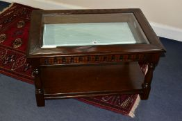 A JAYCEE RECTANGULAR OAK COFFEE TABLE, with a glass bevelled insert revealing the interior of the