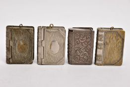 FOUR BRASS BOOK VESTAS, three designed with textured front and back cover and bound spine, two