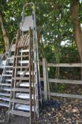 A SET OF ALUMINUM STEP LADDERS height 2.6m and a set of vintage wooden step ladders