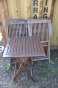 A HARDWOOD SET OF FOUR CHAIRS with a matching table 60cm squared x height 75cm (5)