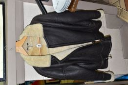 A MODERN 'ORIGINAL SHEARLING' FLYING JACKET, labelled as a small, some areas of wear and staining to