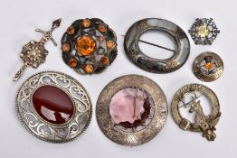 EIGHT SCOTTISH BROOCHES, to include a late Victorian silver oval inlaid blue lace agate brooch, a