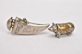 TWO BRASS VESTA CASES, the first in the form of a pig, the second of tapered 'tooth' shape with