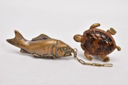 TWO BRASS VESTA CASES, the first in the form of a turtle, the lid hinged at the neck, with plastic