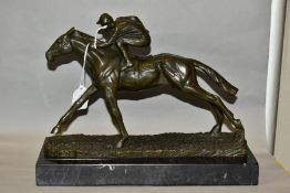 A BOXED REPRODUCTION BRONZE OF A HORSE AND JOCKEY, mounted on a marble style base, length overall