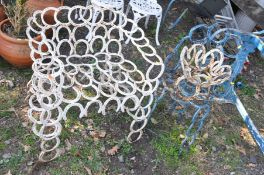 THREE VARIOUS GARDEN ORNAMENTS/CHAIRS made from horse shoes, to include a large arm chair 74cm wide,