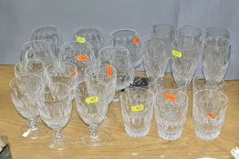 A SUITE OF WATERFORD CRYSTAL COLEEN PATTERN DRINKING GLASSES comprising six brandy, six wine, height