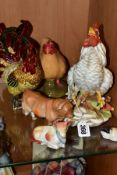 SIX VARIOUS CERAMICS AND METAL MODELS OF POULTRY AND FARM ANIMALS, comprising a Capodimonte white
