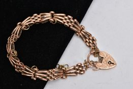 A 9CT ROSE GOLD GATE BRACELET, a three-bar variable link bracelet, fitted to an engraved padlock,