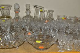 APPROXIMATELY SEVENTY FIVE PIECES OF CUT GLASS AND CRYSTAL, to include three decanters (one
