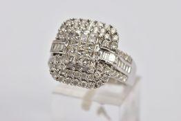 A DIAMOND CLUSTER RING, designed as a central rectangular panel of twelve princess cut diamonds,