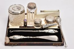 A SELECTION OF SILVERWARE, to include a cased shoe horn and boot pull set, both with embossed silver