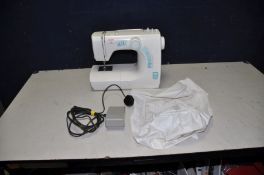 A TOYOTA SE14 ELECTRIC SEWING MACHINE with treadle/power cable and cover (PAT pass and working)