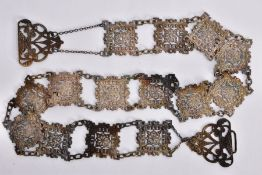 A BELT, designed as square openwork panels with floral and scrolling decoration, to the silver
