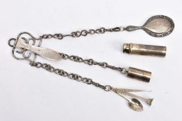 A SILVER CHATELAINE, the late Victorian chatelaine of scrolling wire design, the hinged back section