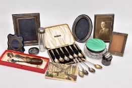 A SELECTION OF SILVER ITEMS, to include five silver photo frames, two silver napkin rings each