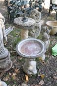 A MODERN COMPOSITE ARMILLARY SPHERE SUN DIAL on top of a foliate detailed column and an along with a