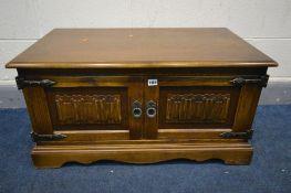 AN OLD CHARM OAK TWO DOOR TV CABINET, width 88cm x depth 49cm x height 46cm