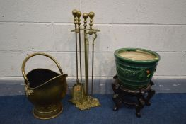 A BRASS THREE PIECE COMPANION SET, with a matching stand, a brass coal bucket, glazed planter and an