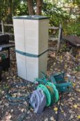 A PLASTIC GARDEN CUPBOARD with four doors width 66cm x depth 49cm x height 152cm along with two hose