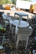WHITE UPVC GARDEN FURNITURE comprising of a table 90cm diameter, two sets of four arm chairs and a