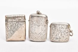 A LATE VICTORIAN SILVER VESTA AND TWO EARLY 20TH CENTURY VESTAS, the Victorian vesta of a rounded