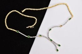 A MODERN 18CT GOLD DIAMOND AND EMERALD LINE NECKLACE, oval mixed cut emeralds each measuring