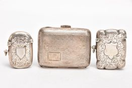 TWO SILVER VESTAS AND A SILVER CIGARETTE CASE, the first vesta of a rectangular form, wavy edge