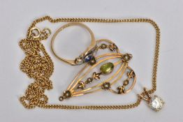 THREE ITEMS OF JEWELLERY, to include an Edwardian 9ct gold openwork peridot and split pearl pendant,