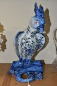 A LATE 19TH/EARLY 20TH CENTURY BLUE AND WHITE FAIENCE PARROT BOUGH POT, restored head, plume,